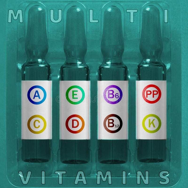 Multivitamins using concept. Four ampules with overlay colored letters of inscription A C E D K PP B6 B12 vitamin elements. In circles. Medical ampules of royalty free stock photography