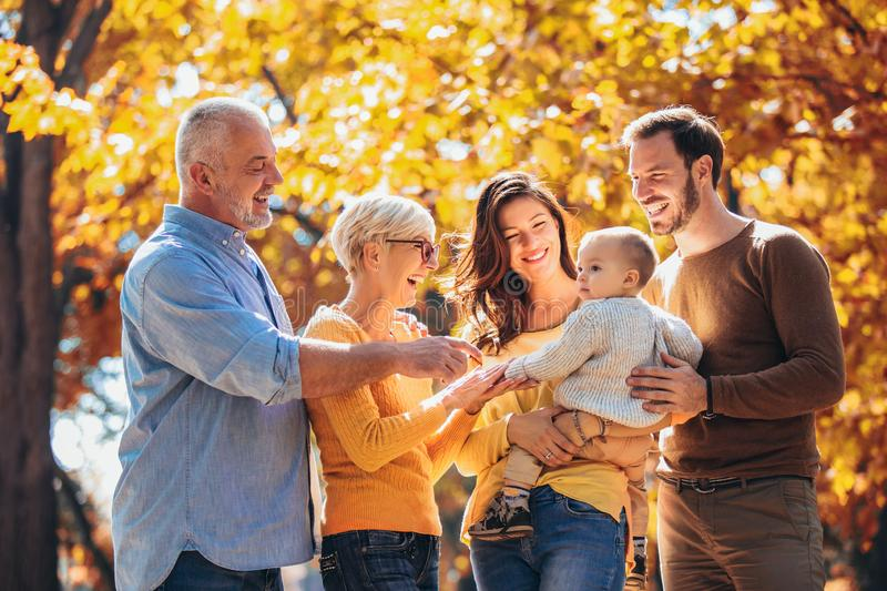 Multi generation family in autumn park royalty free stock photo