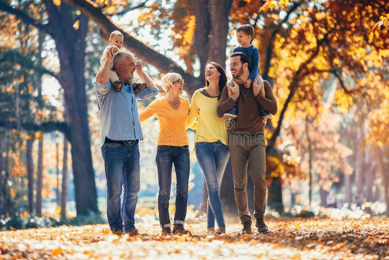 Multl generation family in autumn park. Having fun stock photography