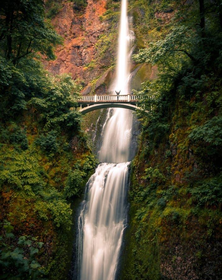 Multnomah Falls, Columbia River Gorge, Oregon. Person on Multnomah Falls Bridge. Columbia River Gorge, Oregon, USA royalty free stock photography