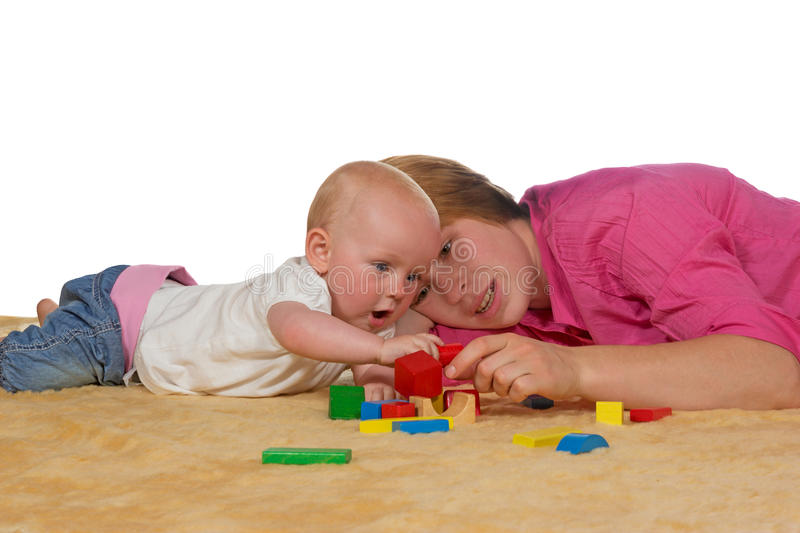 Mum and baby playing with building blocks stock images