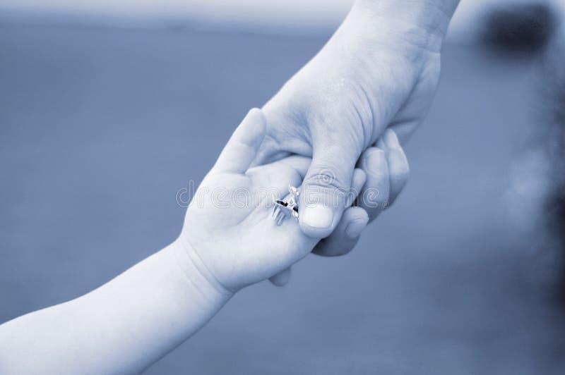 Mum&child's hands(monochrome) stock images