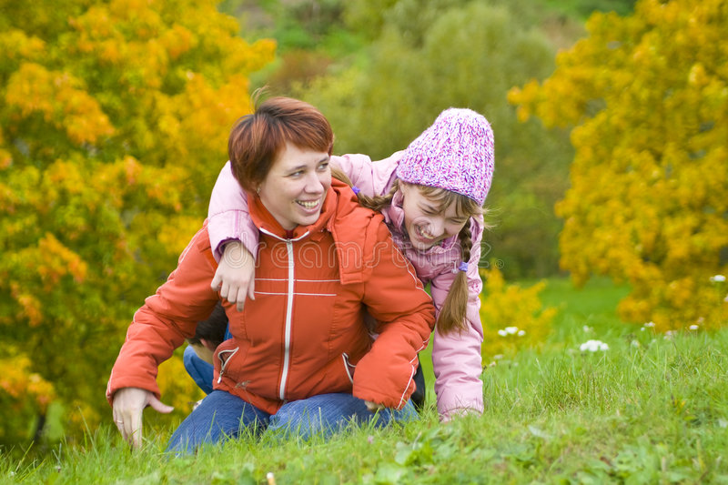 Mum with a daughter stock images
