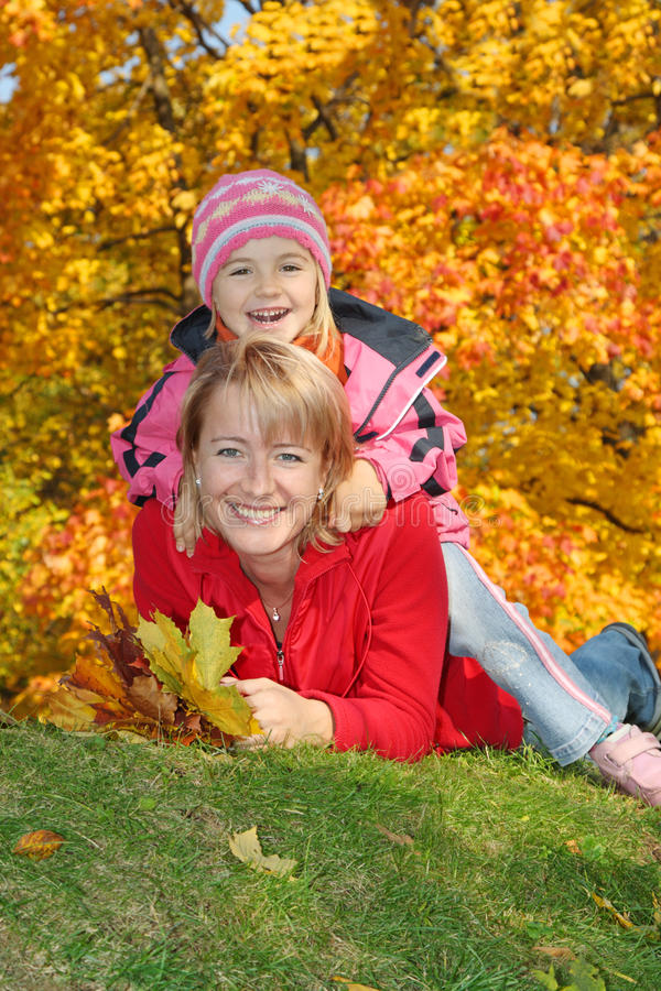 Download Mum With A Daughter In Autumn Park Stock Photo - Image: 10961290