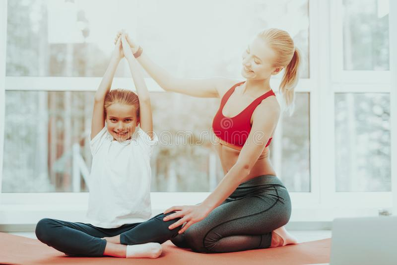 Mum And Daughter Back Stretching. Laptop Screen. Active Lifestyle. Relaxing Together. Doing Fitness At Home. Holiday Leisure. Body Balance. Sport Exercise royalty free stock photography