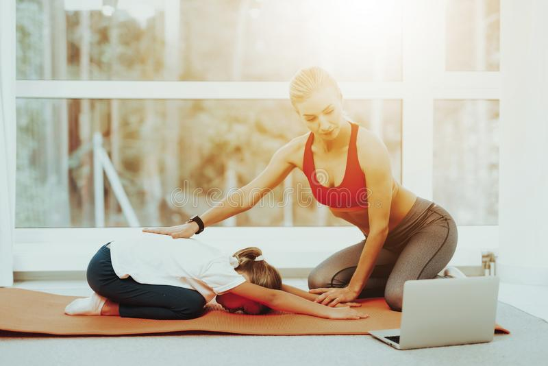 Mum And Daughter Back Stretching. Laptop Screen. Active Lifestyle. Relaxing Together. Doing Fitness At Home. Holiday Leisure. Body Balance. Sport Exercise stock photography