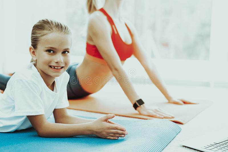 Mum And Daughter Back Stretching. Yoga Training. Active Lifestyle. Relaxing Together. Doing Fitness At Home. Holiday Leisure. Body Balance. Sport Exercise stock photos