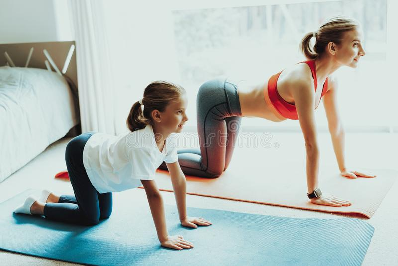 Mum And Daughter Back Stretching. Yoga Training. Active Lifestyle. Relaxing Together. Doing Fitness At Home. Holiday Leisure. Body Balance. Sport Exercise stock photography