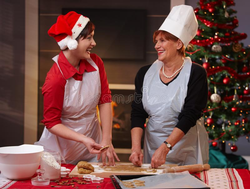 Mum and daughter laughing at christmas baking royalty free stock photos