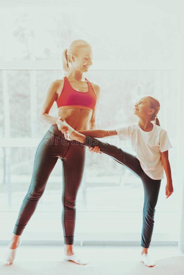 Mum And Daughter Legs Stretching. Yoga Training. Active Lifestyle. Relaxing Together. Doing Fitness At Home. Holiday Leisure. Body Balance. Sport Exercise stock photo