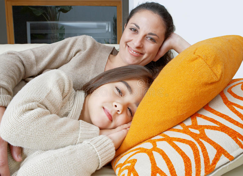 Mum and daughter sleeping on couch stock photos