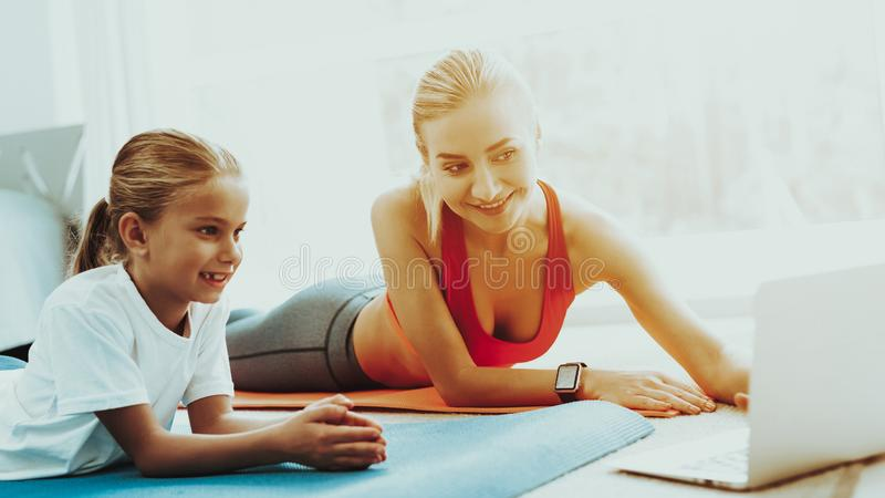 Mum And Daughter Stare On Laptop. Have A Break. Mum And Daughter Are Staring On The Laptop Screen. Have A Break. Relaxing Together. Fitness At Home. Holiday stock images