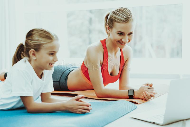 Mum And Daughter Stare On Laptop. Have A Break. Mum And Daughter Are Staring On The Laptop Screen. Have A Break. Relaxing Together. Fitness At Home. Holiday stock photos