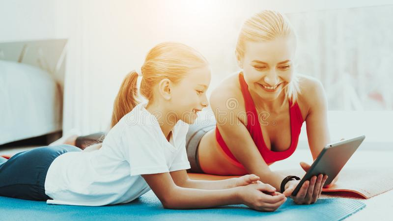 Mum And Daughter Stare On Laptop. Have A Break. Mum And Daughter Are Staring On The Laptop Screen. Have A Break. Relaxing Together. Fitness At Home. Holiday royalty free stock image