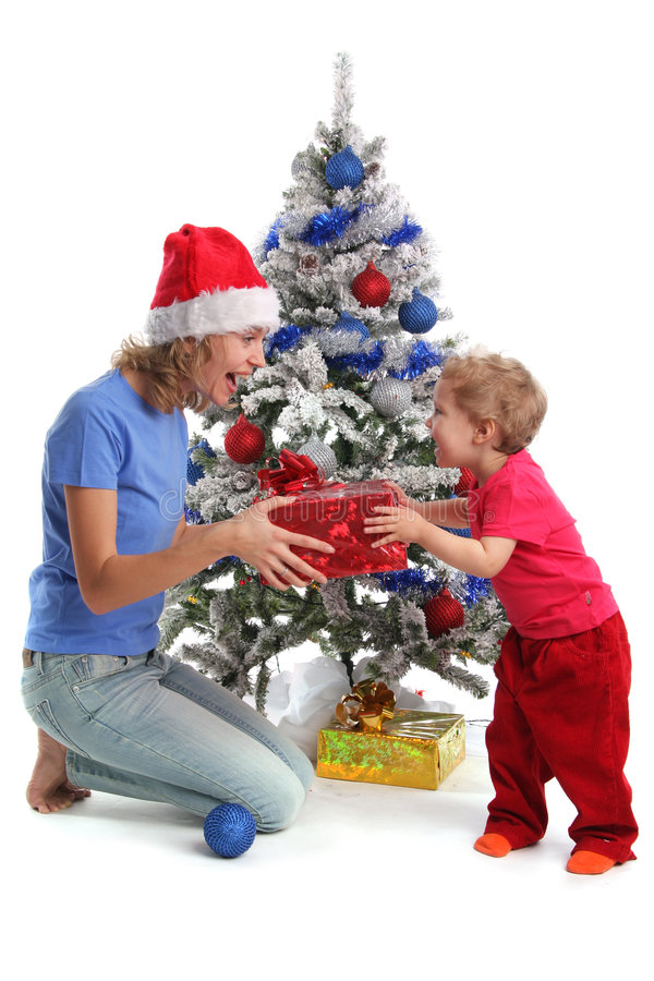 Download Mum Gives A Gift To The Daughter For Christmas Stock Photo - Image: 7171510