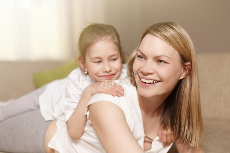 Mum and her cute daughter child girl are playing, smiling and hugging. Happy mother`s day. Family holiday and. Togetherness stock image