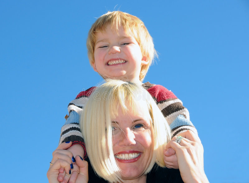 Mum Holding Son On Shoulders Royalty Free Stock Photo