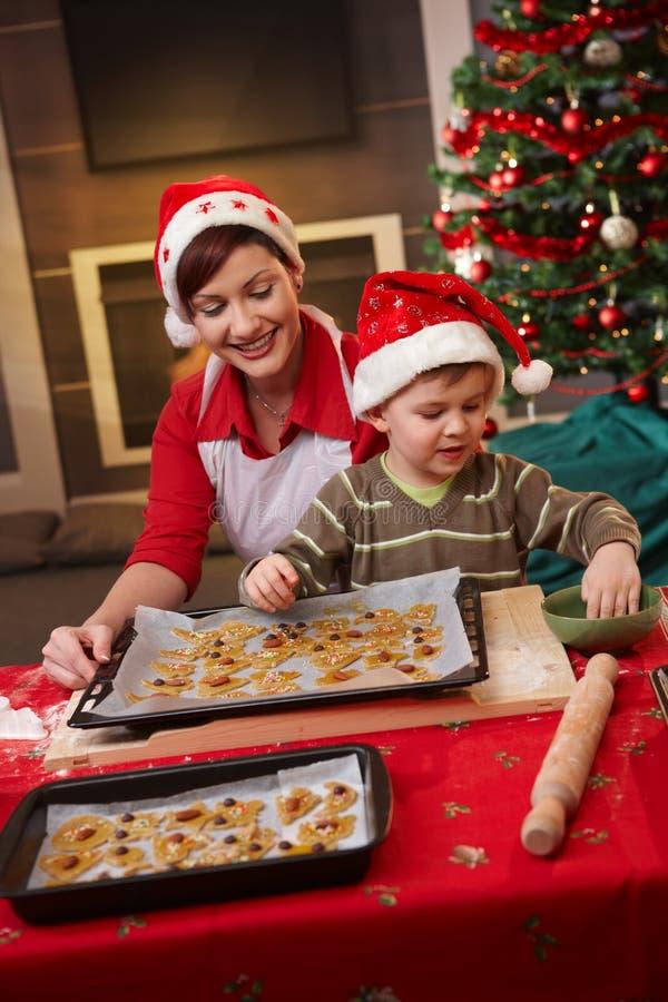 Mum And Son Decorating Christmas Cake Royalty Free Stock Photos