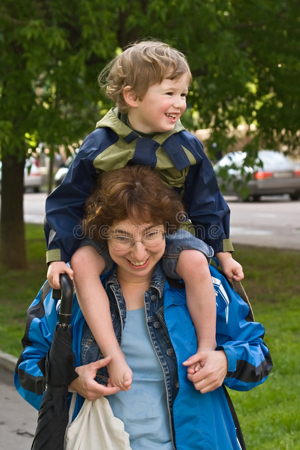 Mum and son after shopping stock photos