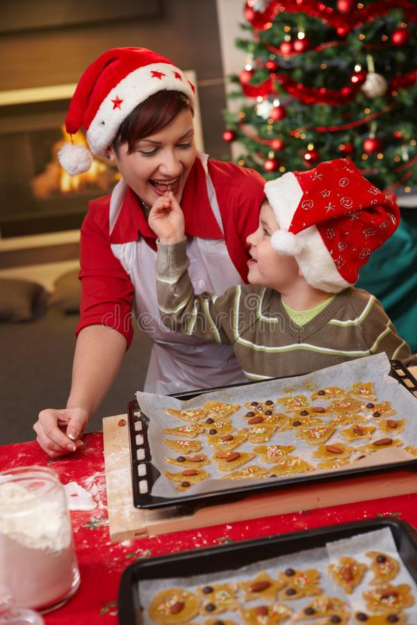 Mum and son tasting christmas cake stock image