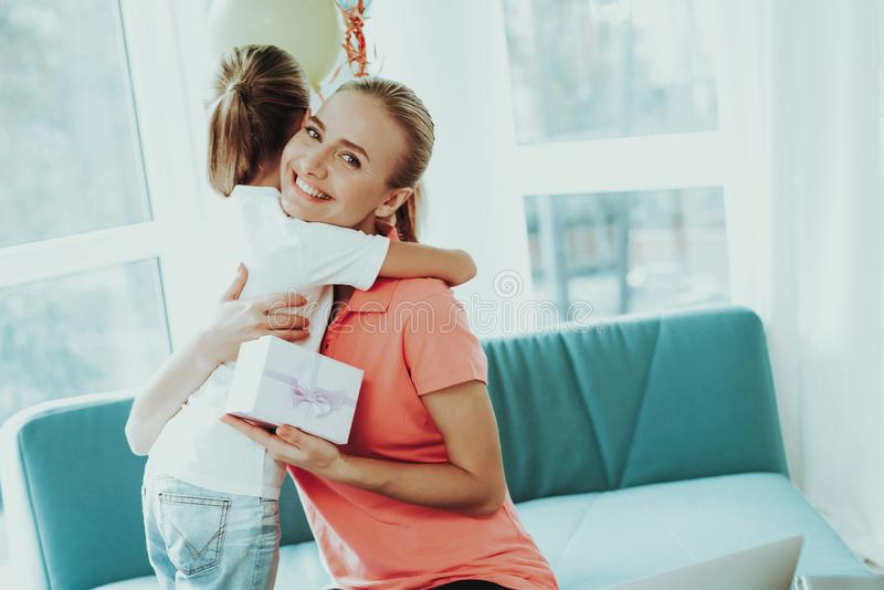 Mum Works On Laptop. Daughter`s Present Concept. Mother Works On A Laptop. Daughter`s Present Concept. Work From Home. Family Relationship. Active Holiday royalty free stock photo