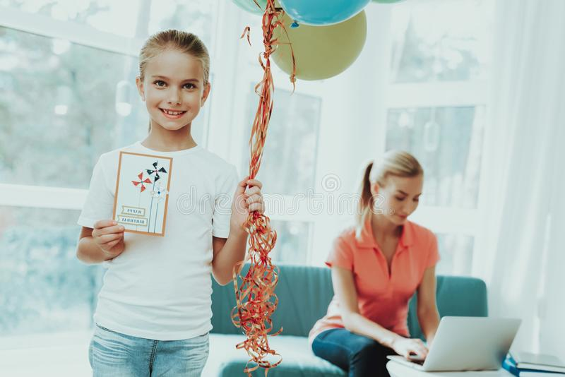 Mum Works On Laptop. Daughter`s Present Concept. Mother Works On A Laptop. Daughter`s Present Concept. Work From Home. Family Relationship. Active Holiday stock photography