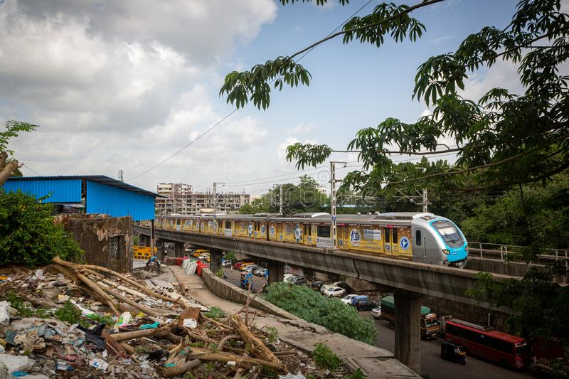 Mumbai,India,August-22-2019: Pieces of cut tree lying along the side. These trees are cut for slum buildings across the Reliance. Metro line in Asalpha area stock photography
