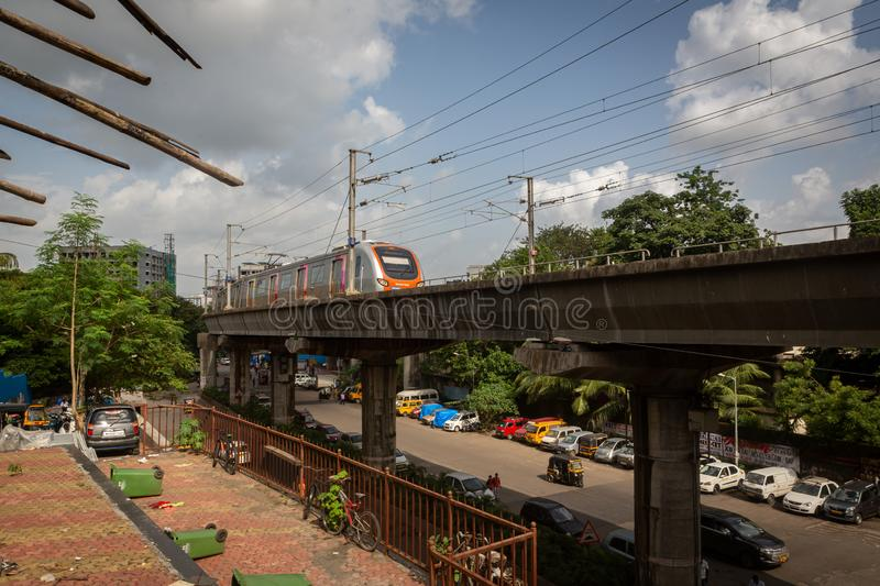Mumbai,India,August-22-2019:Mumbai`s Reliance metro rail line running through suburban slum area of Asalpha. It has reduced. Mumbai`s Reliance metro rail line stock photo
