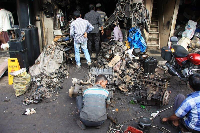 Mumbai/India - 22/11/14 - Car Breaker demolishing part of an engine in the Thieves Market, Mumbai stock photos