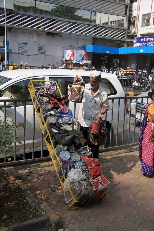Mumbai/India - 24/11/14 - Dabbawala delivery at Churchgate Railway Station in Mumbai with dabbawala unloading tiffins royalty free stock images