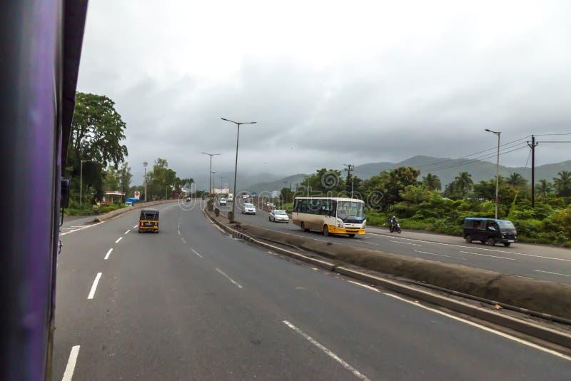 Mumbai, Maharashtra. August 25 2018: Thane Road in mumbai During Raining season India one of the major cities in the Indian state royalty free stock photo