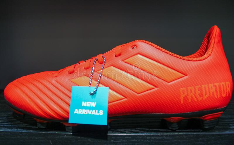 Mumbai, Maharastra/ India-april-20-2019. Adidas foot ball boots new arrival blue colour taken on a isolated black background. stock photo