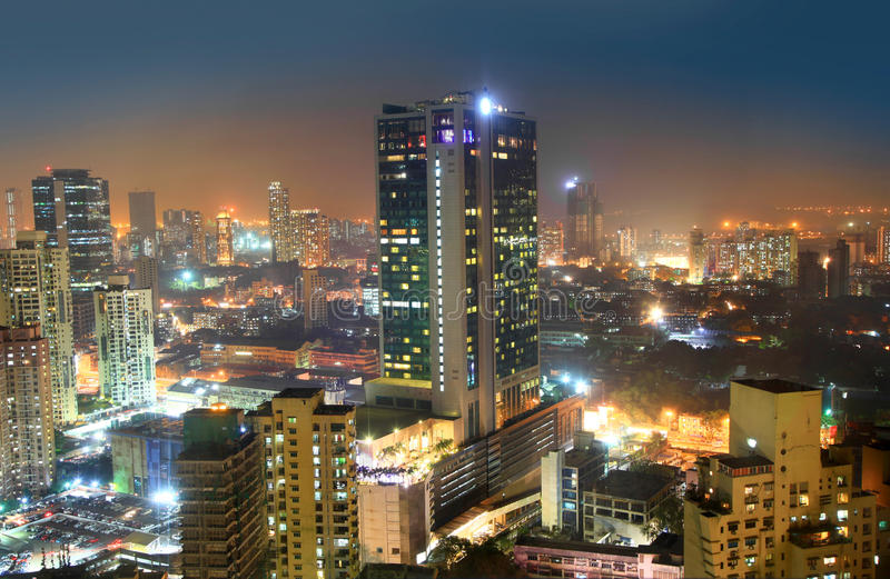 Mumbaistad in nacht stock afbeeldingen