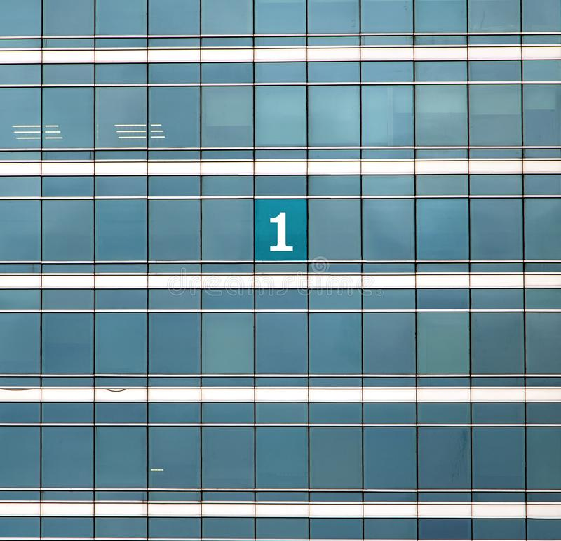 The mumber One on the building`s window. royalty free stock photos