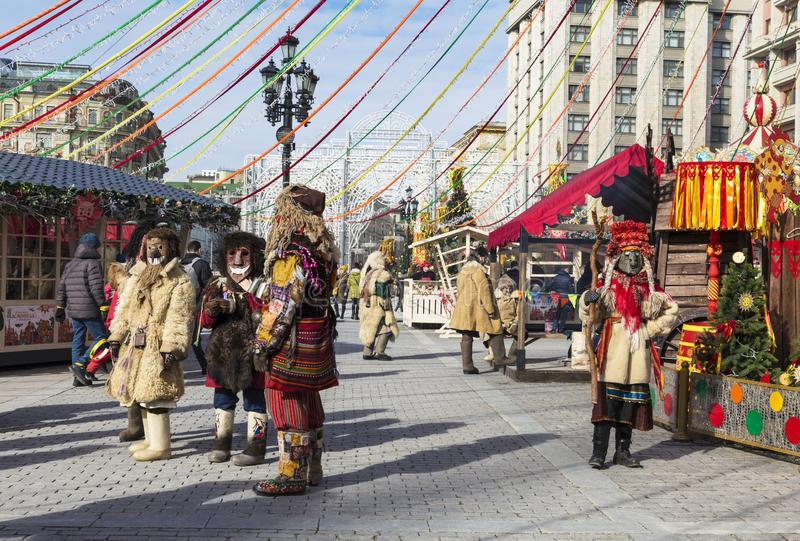Mummers at the celebration of Maslenitsa at the Manege square in Moscow royalty free stock photography