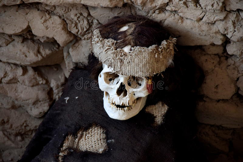 A mummy in Chauchilla Cemetery. A mummy in the ancient burial site of Chauchilla Cemetery near Nazca in Peru royalty free stock photography