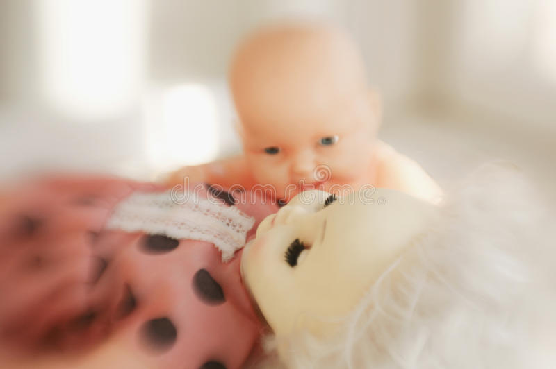 Mummy sleeps. Toy doll lying blindly and toy naked doll nearby. (first photo from Dolls as People series royalty free stock photography