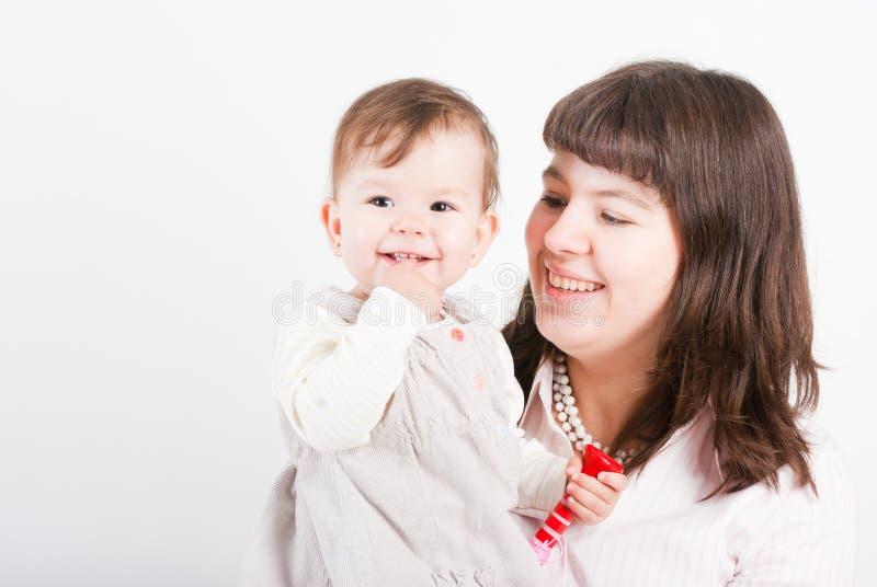 Mums felizes do retrato com uma filha fotografia de stock royalty free