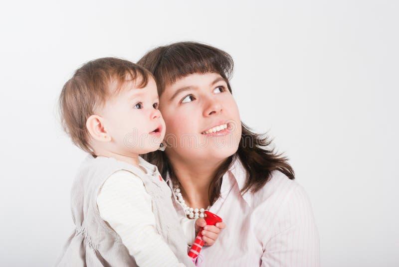 Mums felizes do retrato com uma filha imagens de stock