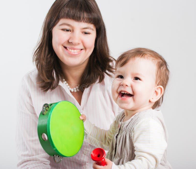 Mums felizes do retrato com uma filha foto de stock