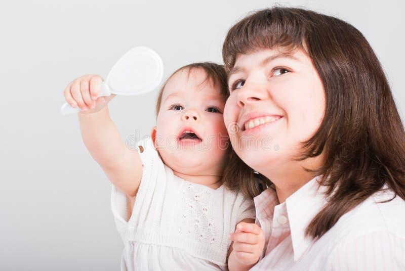 Mums felizes do retrato com uma filha fotos de stock royalty free