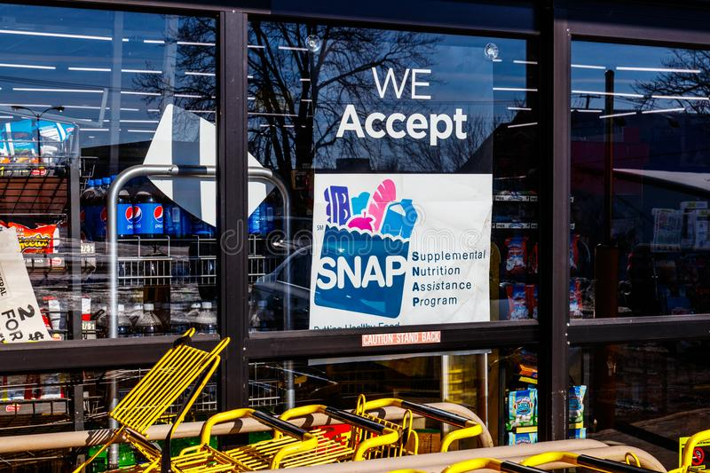 Muncie - Circa January 2018: A Sign at a Retailer - We Accept SNAP royalty free stock images