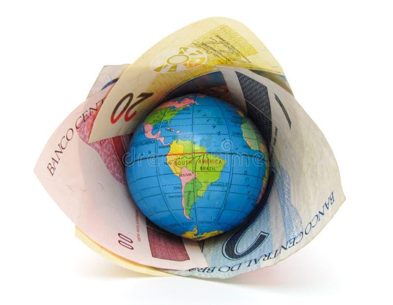 Mundo dominado pela moeda brasileira fotografia de stock royalty free