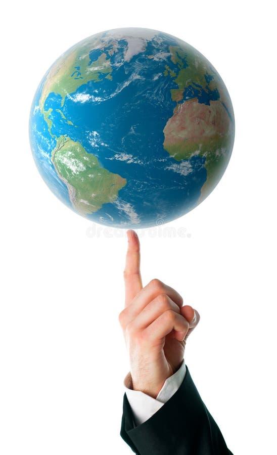 Mundo en un dedo humano imagenes de archivo