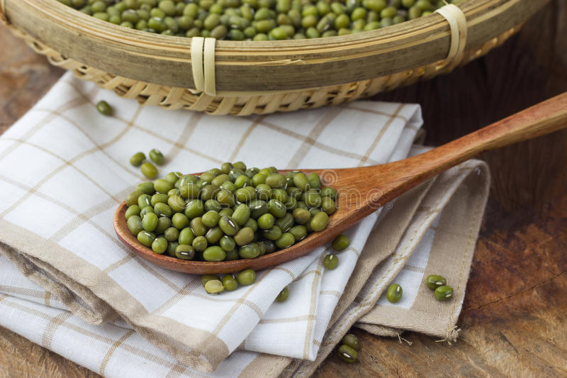 Mung bean in a wooden spoon stock photo