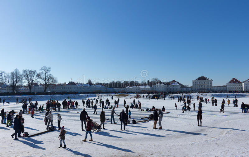 MUNICH – JANUARY 28: Families enjoying beautiful winter weather royalty free stock photos