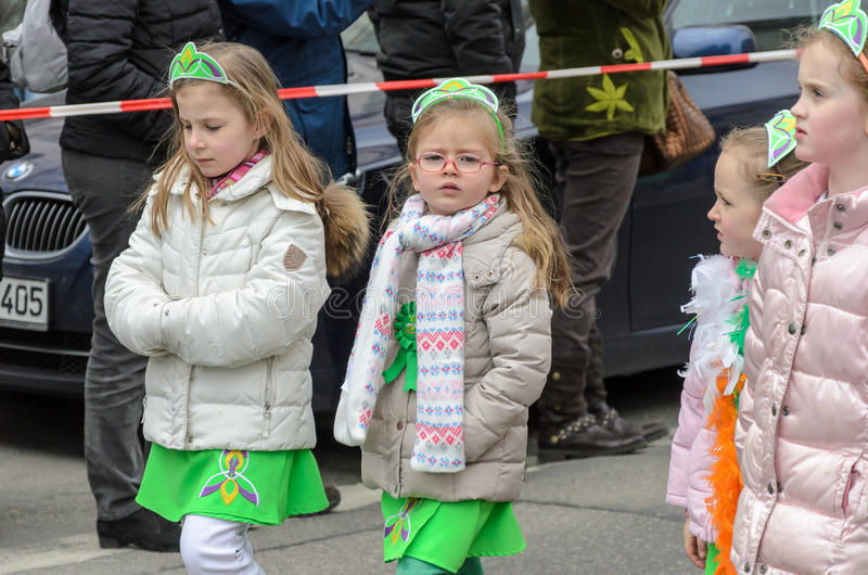 MUNICH, BAVARIA, GERMANY - MARCH 13, 2016: Close up on group of little girls representing the Irish princess group at the St. Pat stock photo