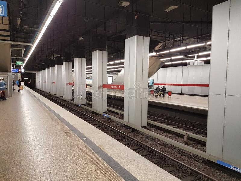 MUNICH, GERMANY - APRIL 2, 2020: A photo of a old subway train arriving to a deserted  Main Trainstation station in Munich. Germany, in the time of the royalty free stock photos