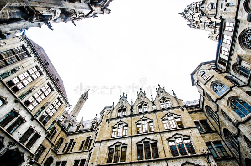 MUNICH, GERMANY - August 29, 2019: Town Hall in the Marienplatz in Munich, view from below. MUNICH, GERMANY - August 29, 2019: New Town Hall in the Marienplatz royalty free stock images