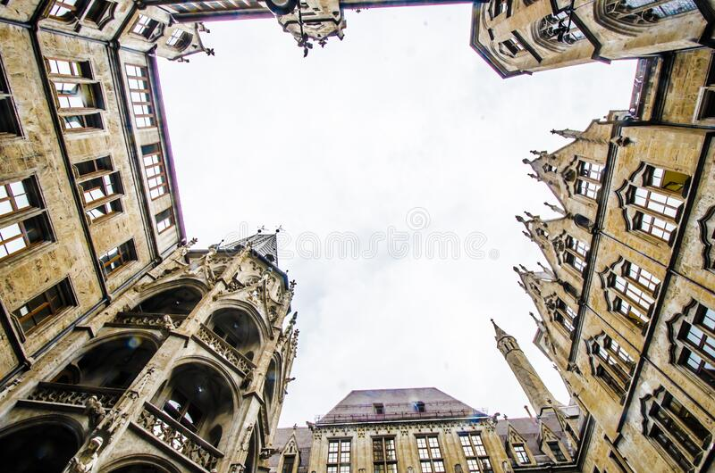 MUNICH, GERMANY - August 29, 2019: Town Hall in the Marienplatz in Munich, view from below. MUNICH, GERMANY - August 29, 2019: New Town Hall in the Marienplatz royalty free stock photography